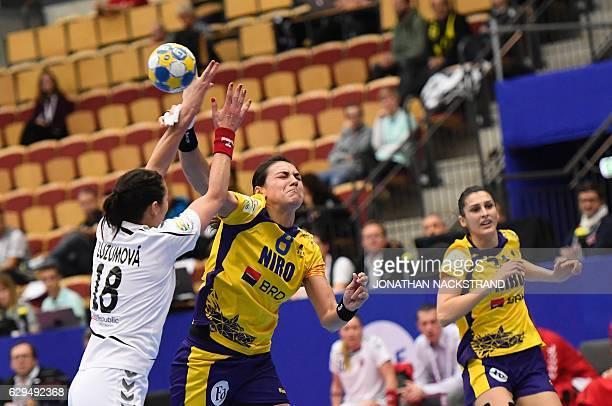 Czech Republic's Iveta Luzumova blocks Romania's Cristina Neagu as she throws the ball during the Women's European Handball Championship Group II...