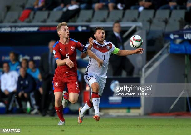 Czech Republic's Jakub Brabec and Germany's Kevin Volland battle for the ball