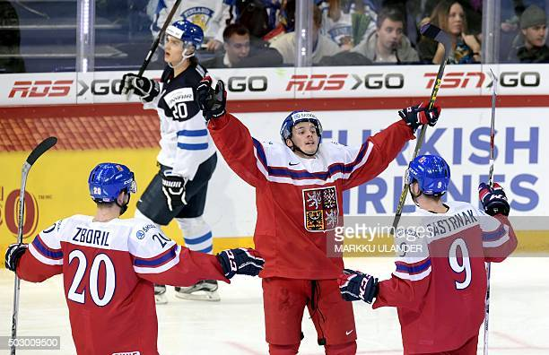 Czech Republic's Jakub Zboril goal scorer Michael Spacek and David Pastrnak celebrate 34 goal during the 2016 IIHF World Junior U20 Ice Hockey...