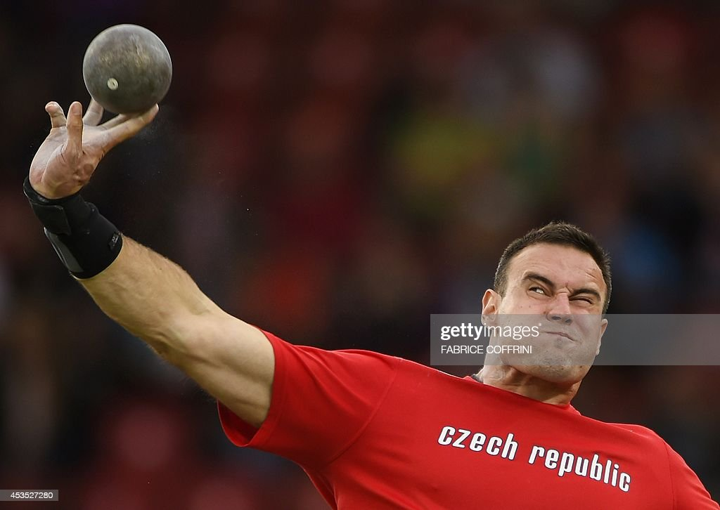 Czech Republic's Jan Marcell competes in the Men's Shot Put final during the European Athletics Championships at the Letzigrund stadium in Zurich on August 12, 2014. AFP PHOTO / FABRICE COFFRINI