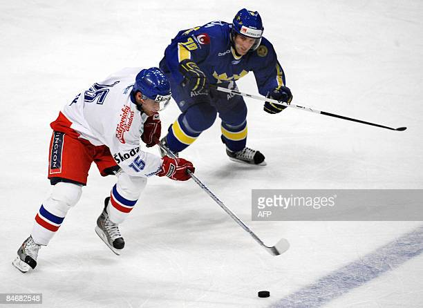 Czech Republic's Jan Marek vies with Sweden's Martin Thornberg in their match of the Euro hockey tour in Stockholm on February 7 2009 Sweden won the...