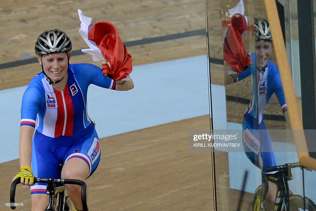 Czech Republic's Jarmila Machacova celebrates her gold medal in UCI Track Cycling World Championships Women's 25 km Point Race in Belarus' capital of Minsk on February 23, 2013. AFP PHOTO/KIRILL KUDRYAVTSEV