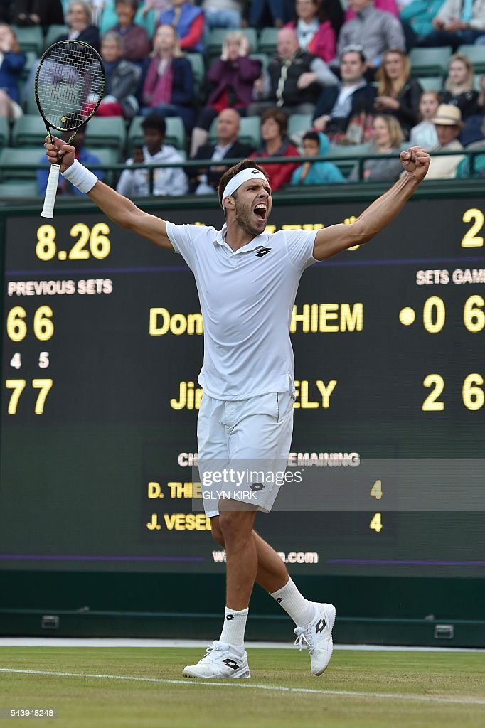 Czech Republic's Jiri Vesely celebrates beating Austria's Dominic Thiem during their men's singles second round match on the fourth day of the 2016 Wimbledon Championships at The All England Lawn Tennis Club in Wimbledon, southwest London, on June 30, 2016. / AFP / GLYN