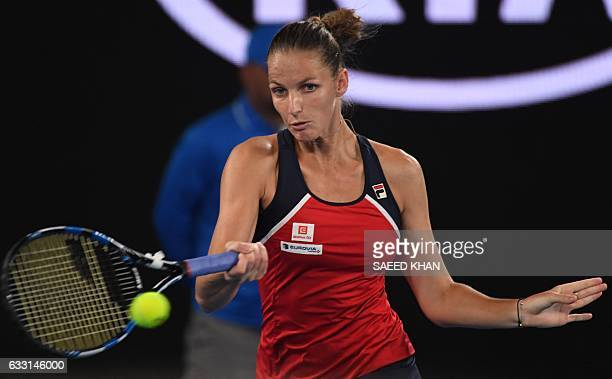 Czech Republic's Karolina Pliskova hits a return against Australia's Daria Gavrilova during their women's singles fourth round match on day eight of...