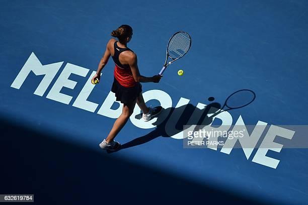 Czech Republic's Karolina Pliskova prepares to serve while playing against Croatia's Mirjana LucicBaroni during their women's singles quarterfinal...