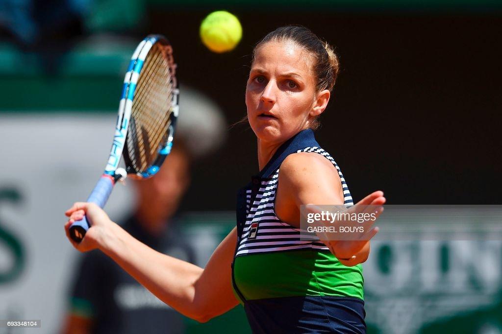 Czech Republic's Karolina Pliskova returns the ball to France's Caroline Garcia during their tennis match at the Roland Garros 2017 French Open on June 7, 2017 in Paris. /