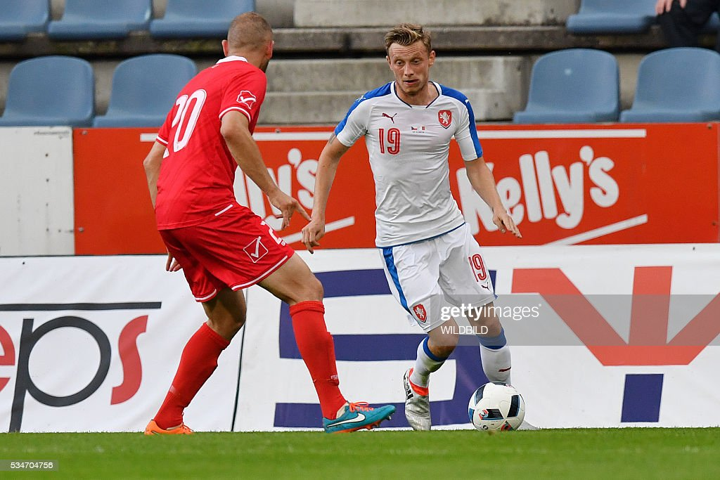 Czech Republic's Ladislav Krejci (R) vies for the ball with Malta's Clifford Gatt Baldacchino during the friendly football match between Czech Republic and Malta in Kufstein, Austria, on May 27, 2016. / AFP / Wildbild