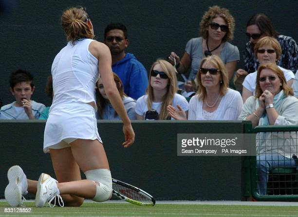 Czech Republic's Lucie Safarova slips as the spectators look on during her match against Serbia's Jelena Jankovic during The All England Lawn Tennis...
