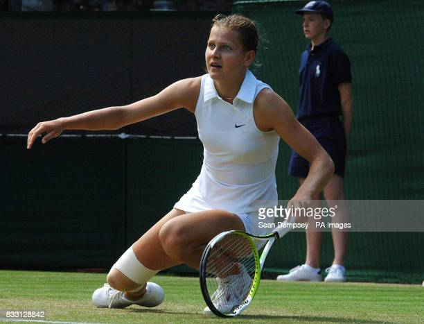 Czech Republic's Lucie Safarova slips during her match against Serbia's Jelena Jankovic during The All England Lawn Tennis Championship at Wimbledon