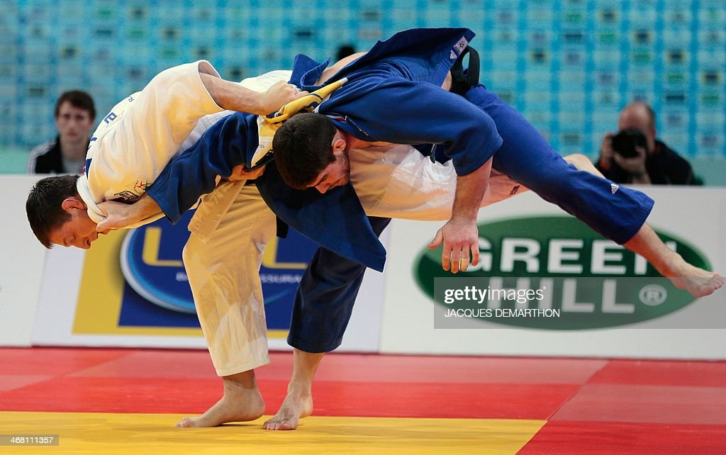 Czech Republic's Lukas Krpalek competes with France's Cyrille Maret during the men's 100kg final at the 2014 Paris Judo Grand Slam tournament on...