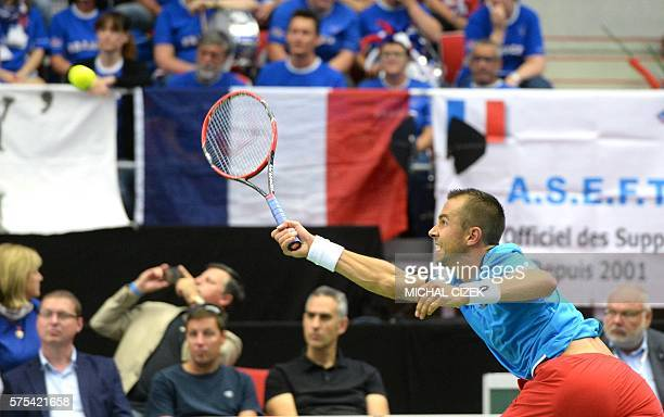 Czech Republic's Lukas Rosol returns a ball to French's JoWilfried Tsonga during the International Tennis Federation Davis Cup quarterfinal match...