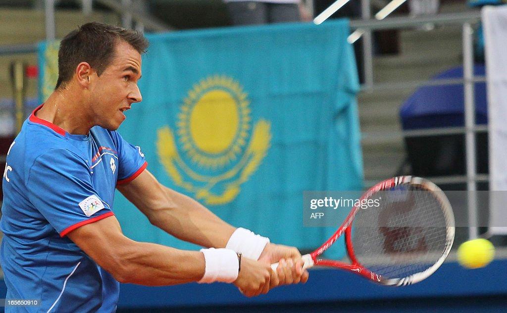 Czech Republic's Lukas Rosol returns a shot against Kazakhstan's Andrey Golubev during their Davis Cup quarterfinal in the Kazakh capital Astana, on April 5, 2013.