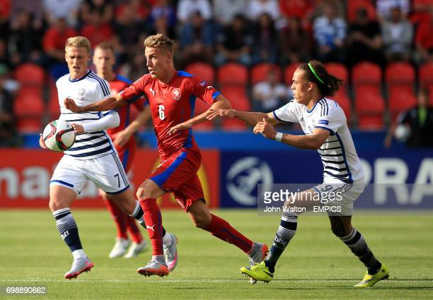 Czech Republic's Ondrej Petrak runs past the challenge of Denmark's Yussuf Poulsen