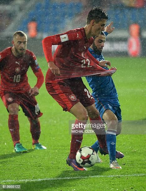 Czech Republic's Patrik Schick and Azerbaijan's Arif Dashdemirov vie for the ball during the WC 2018 football qualification match between Czech...