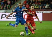 Czech Republic's Pavel Kaderabek vies for the ball with Iceland's Kolbeinn Sigthorsson during the UEFA 2016 European Championship qualifying round...