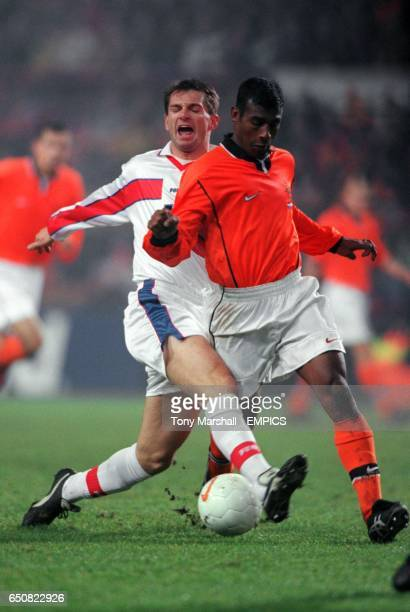 Czech Republic's Pavel Kuka tackles Holland's Aron Winter