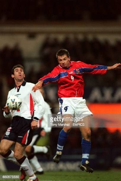 Czech Republic's Pavel Kuka tries a header at goal as England's Martin Keown looks on