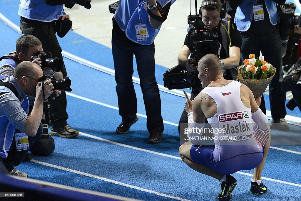 Czech Republic's Pavel Maslak (R) celebrates in front of photographers after vwinning the men's 400m final at the European Indoor Athletics Championships in Gothenburg, Sweden, on March 3, 2013.