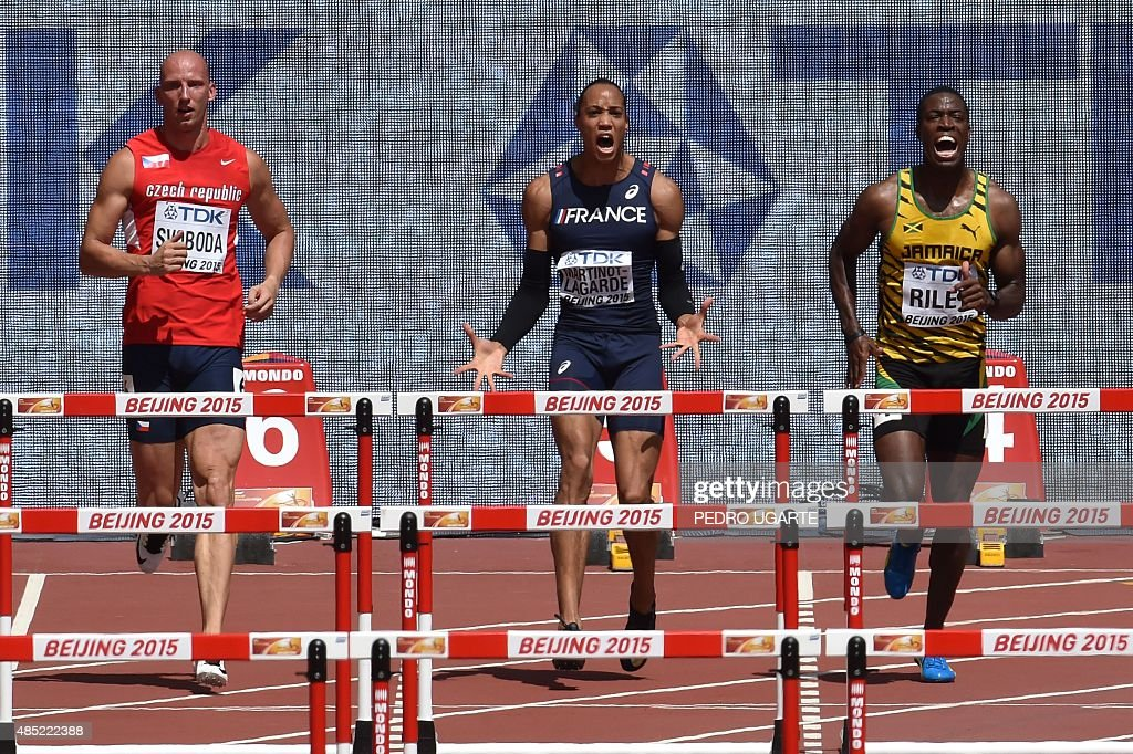 Czech Republic's Petr Svoboda, France's <a gi-track='captionPersonalityLinkClicked' href=/galleries/search?phrase=Pascal+Martinot-Lagarde&family=editorial&specificpeople=7114926 ng-click='$event.stopPropagation()'>Pascal Martinot-Lagarde</a> and Jamaica's Andrew Riley react after a false start during the men's 110 metres hurdles athletics event at the 2015 IAAF World Championships at the 'Bird's Nest' National Stadium in Beijing on August 26, 2015.