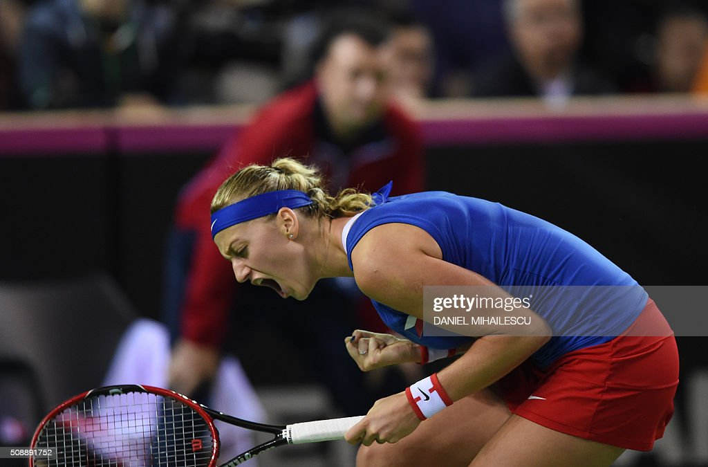 Czech Republic's Petra Klitova celebrates a point against Romania's Simona Halep (unseen) during the FedCup tennis match at 'Sala Polivalenta Cluj Napoca' hall in Cluj Napoca city, on February 7, 2016. / AFP / DANIEL MIHAILESCU