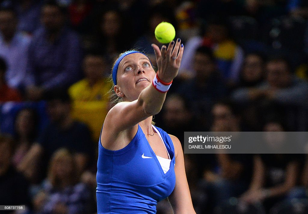 Czech Republic's Petra Klitova serves the ball to Romania's Monica Niculescu during FedCup World Cup first round tennis match at 'Sala Polivalenta Cluj Napoca' hall in Cluj Napoca city February 6, 2015. / AFP / DANIEL MIHAILESCU
