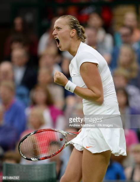 Czech Republic's Petra Kvitova celebrates a point in her match against Belgium's Kirsten Flipkens during day eight of the Wimbledon Championships at...