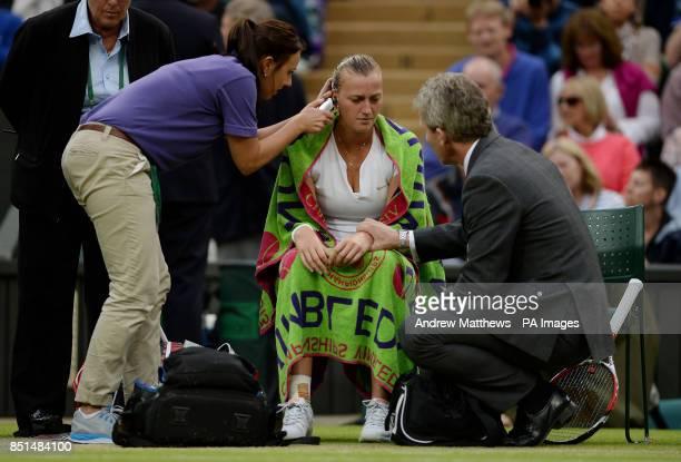 Czech Republic's Petra Kvitova has her temperature taken in her match against Belgium's Kirsten Flipkens during day eight of the Wimbledon...