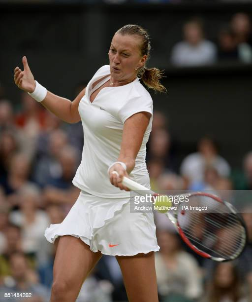 Czech Republic's Petra Kvitova in action against Belgium's Kirsten Flipkens during day eight of the Wimbledon Championships at The All England Lawn...