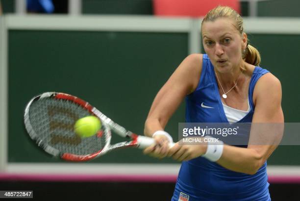 Czech Republic's Petra Kvitova returns a ball to Italy's Roberta Vinci during the 2014 International Tennis Federation Fed Cup World Group semifinal...