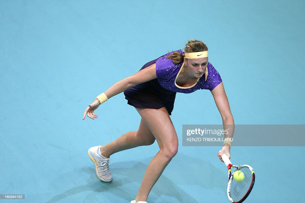 Czech Republic's Petra Kvitova returns the ball to Swiss Stefanie Voegele during their tennis match at the 21st edition of the Paris WTA Open on January 30, 2013. AFP PHOTO / KENZO TRIBOUILLARD