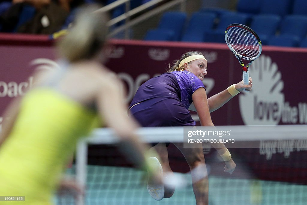 Czech Republic's Petra Kvitova returns the ball to Swiss Stefanie Voegele during their tennis match at the 21st edition of the Paris WTA Open on January 30, 2013.