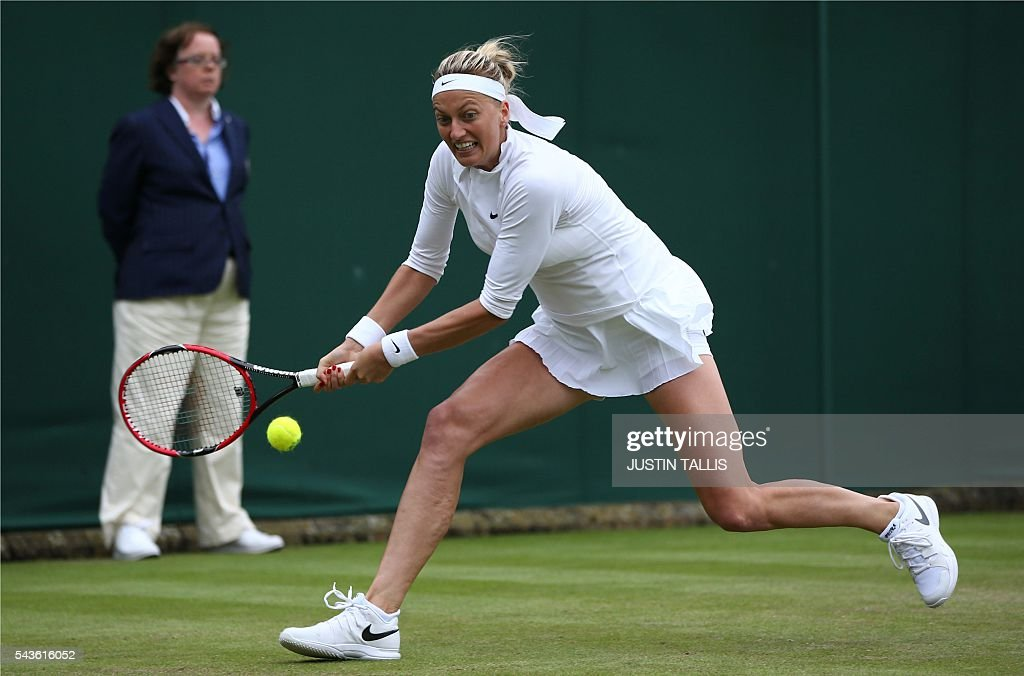 Czech Republic's Petra Kvitova returns to Romania's Sorana Cirstea during their women's singles first round match on the third day of the 2016 Wimbledon Championships at The All England Lawn Tennis Club in Wimbledon, southwest London, on June 29, 2016. / AFP / JUSTIN