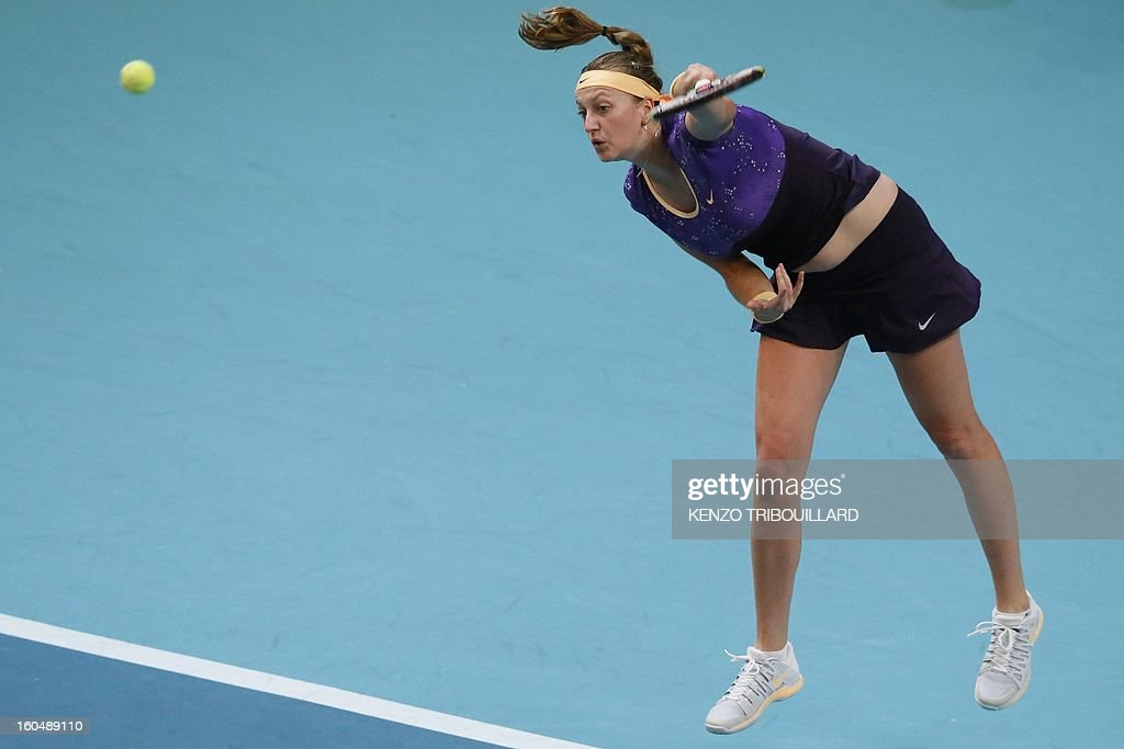 Czech Republic's Petra Kvitova serves to France's Kristina Mladenovic during their tennis match as part of the 21st edition of the Paris WTA Open on February 1, 2013.