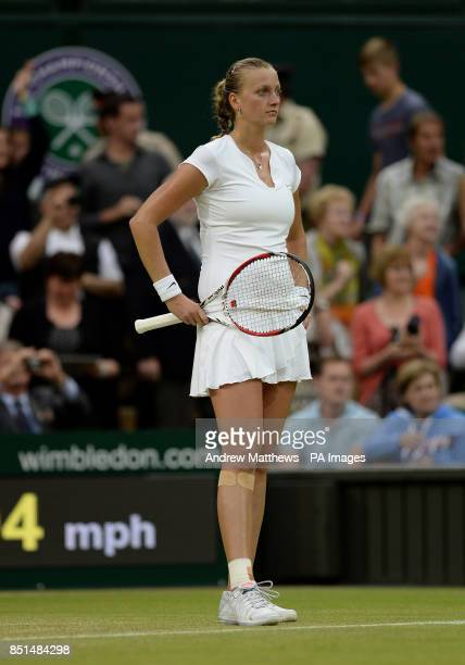 Czech Republic's Petra Kvitova stands dejected in her match against Belgium's Kirsten Flipkens during day eight of the Wimbledon Championships at The...