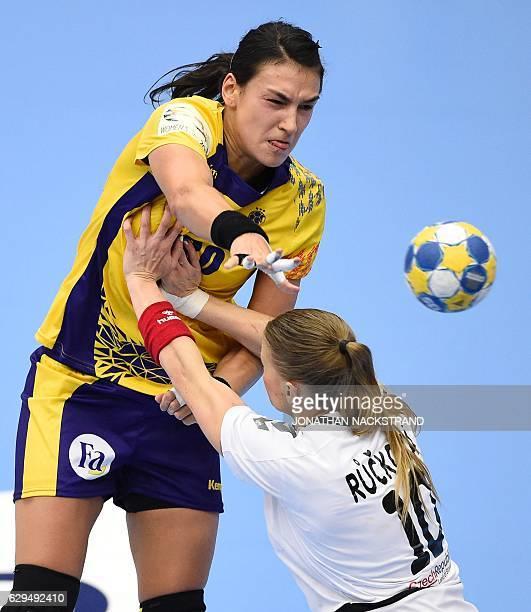 Czech Republic's Petra Ruckova tries to stop Romania's Cristina Neagu as she passes the ball during the Women's European Handball Championship Group...