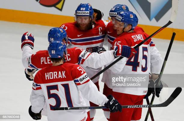 Czech Republic's players celebrate after they scored a goal during the IIHF Men's World Championship group B ice hockey match between France and...