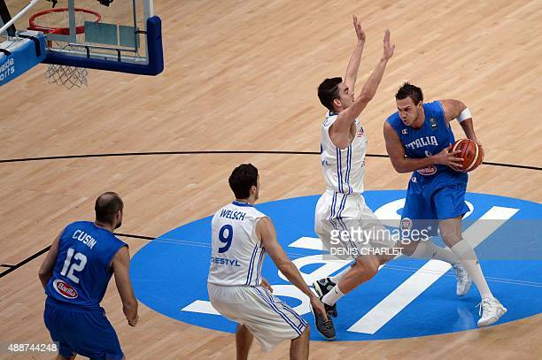 Czech Republic's point guard Tomas Satoransky defends against Italy's small forward Danilo Gallinari during the classification basketball match...