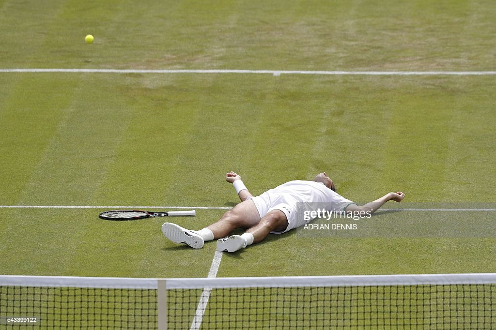 Czech Republic's Radek Stepanek lies on the court after losing his footing against Australia's Nick Kyrgios during their men's singles first round match on the second day of the 2016 Wimbledon Championships at The All England Lawn Tennis Club in Wimbledon, southwest London, on June 28, 2016. / AFP / ADRIAN