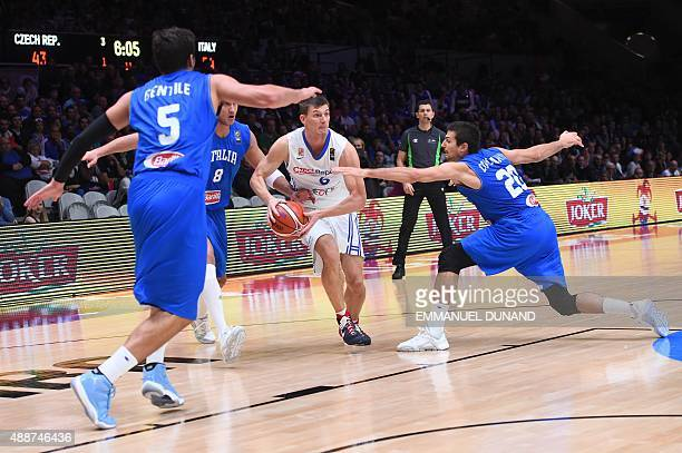 Czech Republic's small forward Pavel Pumprla dribbles his way through Italy's small forward Alessandro Gentile Italy's small forward Danilo Gallinari...