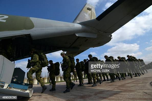 Czech Republic's soldiers from the 43rd airborne battalion line up to board an Casa aircraft during the NATO drill 'The Noble Jump' at the airport in...