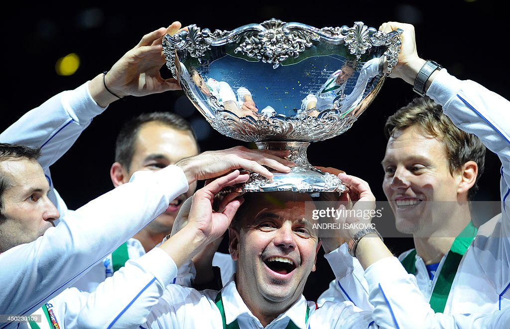 Czech Republic's team members hold up the Davis Cup trophy over their team's captain Vladimir Safarik (C) after winning the Davis Cup tennis match finals between Czech Rebublic and Serbia at the Kombank Arena in Belgrade on November 17, 2013. The Czech Republic defended the Davis Cup title after Radek Stepanek beat Serbian youngster Dusan Lajovic in the decisive fifth final rubber in straight sets on November 17, 2013.