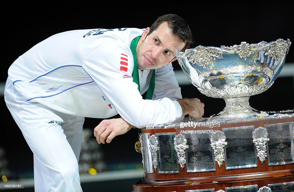 Czech Republic's tennis player Radek Stepanek poses with the Davis Cup trophy after winning the Davis Cup tennis match finals between Czech Rebublic and Serbia at the Kombank Arena in Belgrade on November 17, 2013. The Czech Republic defended the Davis Cup title after Radek Stepanek beat Serbian youngster Dusan Lajovic in the decisive fifth final rubber in straight sets on November 17, 2013.