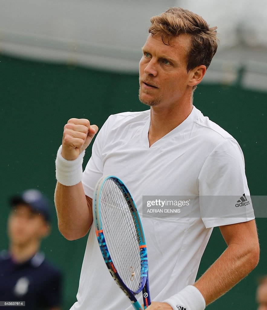 Czech Republic's Tomas Berdych celebrates after beating Croatia's Ivan Dodig in a men's singles first round match on the third day of the 2016 Wimbledon Championships at The All England Lawn Tennis Club in Wimbledon, southwest London, on June 29, 2016. / AFP / ADRIAN