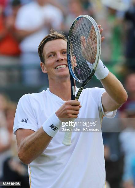 Czech Republic's Tomas Berdych celebrates defeating Australia's Bernard Tomic during day three of the Wimbledon Championships at the All England Lawn...