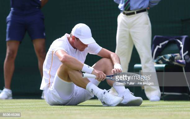 Czech Republic's Tomas Berdych falls in his match against Australia's Bernard Tomic during day three of the Wimbledon Championships at the All...