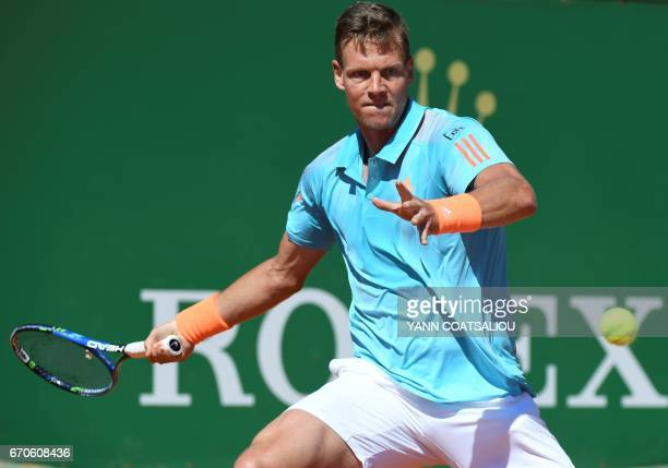 Czech Republic's Tomas Berdych hits a return to Croatia's Marin Cilic during their MonteCarlo ATP Masters Series tennis tournament on April 20 2017...