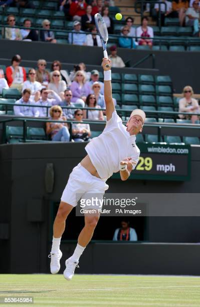Czech Republic's Tomas Berdych in action against Australia's Bernard Tomic during day three of the Wimbledon Championships at the All England Lawn...
