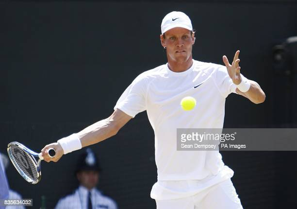 Czech Republic's Tomas Berdych in action against Russia's Nikolay Davydenko during the Wimbledon Championships 2009 at the All England Tennis Club