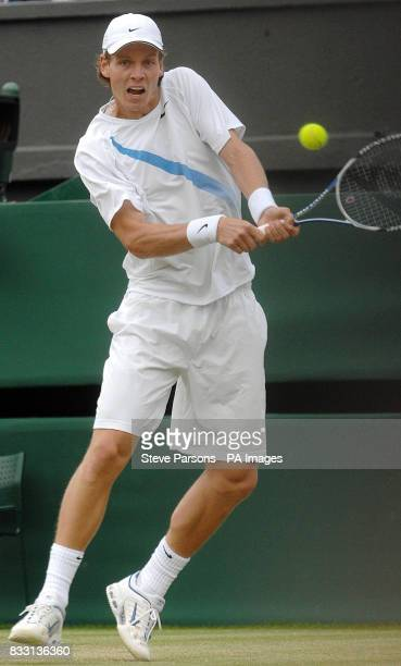 Czech Republic's Tomas Berdych in action against Spain's Rafael Nadal during The All England Lawn Tennis Championship at Wimbledon