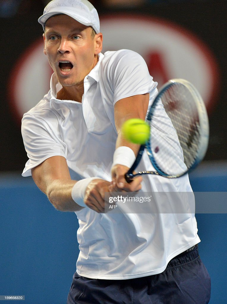 Czech Republic's Tomas Berdych plays a return during his men's singles match against Austria's Jurgen Melzer on the fifth day of the Australian Open tennis tournament in Melbourne on January 18, 2013.